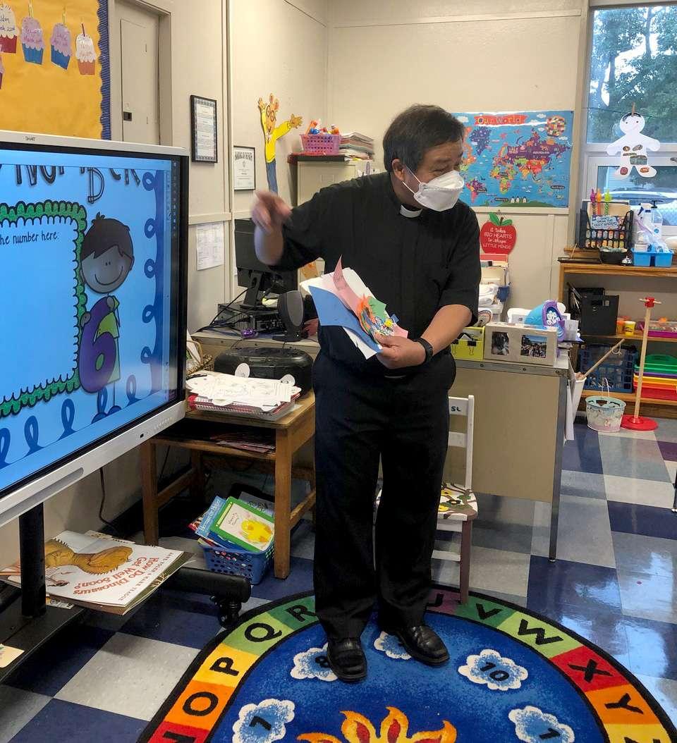 Father DeLeon in classroom